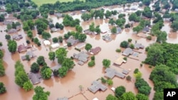 Flooded homes are seen along the Arkansas River in Sand Spring, Okla., in this May 28, 2019, aerial photo.