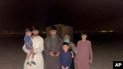 In this photo provided to The Associated Press, Mohammad Khalid Wardak is seen in Afghanistan on Aug. 18, 2021, after the US military and its allies rescued him and his family.