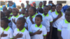 Les pensionnaires du centre orphelinat Dieu Beni chantant l'hymne de la fondation, le 24 décembre 2019. (VOA/André Kodmadjingar).