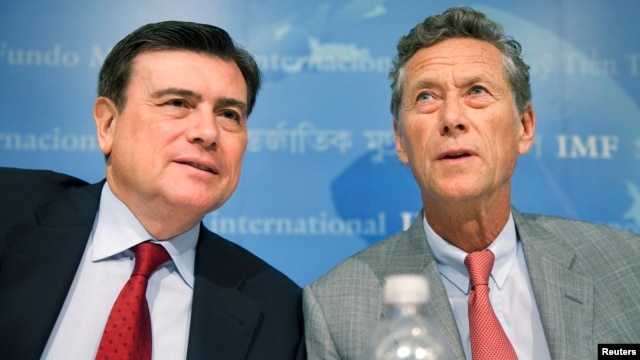 International Monetary Fund officials Jose Vinals (L) and Olivier Blanchard hold a news conference on the release of IMF's World Economic Outlook at the IMF Headquarters in Washington, D.C., July 2009.