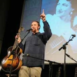 John Carter Cash with his grandmother Maybelle Carter's Gibson L-5 guitar.
