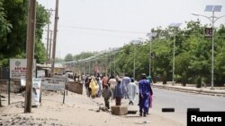 FILE - People flee the northeastern Nigerian city of Maiduguri in Borno State, May 14, 2015.