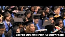 Graduation ceremony last year at Georgia State University. The school has won praise for its efforts to keep students from dropping out. (Photo from Georgia State University)