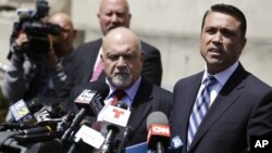 U.S. Rep. Michael Grimm, right, speaks to the media outside of federal court in New York, April 28, 2014.