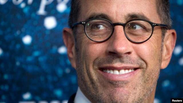 """FILE - Comedian Jerry Seinfeld, pictured in November 2014, says President Barack Obama """"has gotten off just enough funny lines to qualify"""" for an appearance on his Web show, """"Comedians in Cars Getting Coffee."""""""