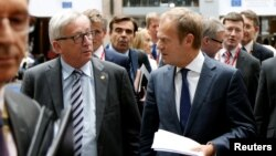 European Commission President Jean-Claude Juncker and European Council President Donald Tusk (R) arrive to address a joint news conference on the second day of the EU Summit in Brussels, Belgium, June 29, 2016.