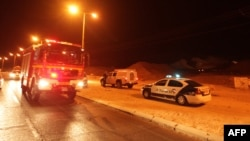 Police and rescue services arrive at the scene of a rocket attack in the Israeli Red Sea resort of Eilat, on August 15, 2012.