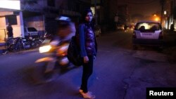 Sheetal, 23, who works at a night call center, poses for a photograph outside her office in New Delhi, January 12, 2013.