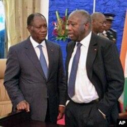 Laurent Gbagbo tare da Alassane Ouattara lokacin wata ganawarsu kafin zabe