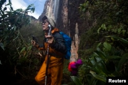 Japanese tourists walk down from the top of Mount Roraima, near Venezuela's border with Brazil, Jan. 18, 2015.