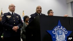 "FILE - Chicago Police Superintendent Eddie Johnson, center, speaks during a news conference Sept. 21, 2016, in Chicago, Illinois. Johnson has described Monday's beating, broadcast live on Facebook, as ""sickening."""
