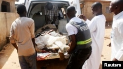 Security officials evacuate victims of a bomb attack at St. Rita's Catholic church in the Malali village in Nigeria's northern city of Kaduna, Oct. 28, 2012.