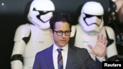 FILE - Director JJ Abrams arrives at the European Premiere of Star Wars, The Force Awakens in Leicester Square, London, Dec.16, 2015.