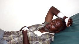 A victim of the Tana River clashes between the pastoralists and farmers within the delta region rests inside a ward at the Malindi District hospital in Kenya, September 7, 2012.