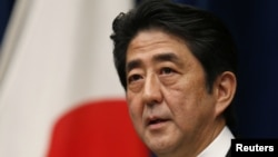 Japan's Prime Minister Shinzo Abe attends a news conference at his official residence in Tokyo, December 26, 2012.