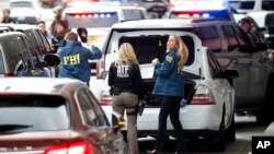 Members of the ATF and FBI arrive at Fort Lauderdale–Hollywood International Airport, Jan. 6, 2017, in Fort Lauderdale, Fla. A gunman opened fire in the baggage claim area at the airport Friday, killing five people and wounding others before being taken i