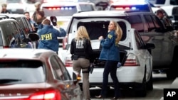 Members of the ATF and FBI arrive at Fort Lauderdale–Hollywood International Airport, Jan. 6, 2017, in Fort Lauderdale, Fla. A gunman opened fire in the baggage claim area at the airport Friday, killing five people and wounding others before being taken into custody.