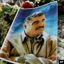A photo of slain Lebanese former Prime Minister Rafiq Hariri is seen on his grave at Martyr's Square, central Beirut, Lebanon, 03 Mar 2005