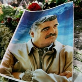 A photo of slain Lebanese former Prime Minister Rafiq Hariri is seen on his grave at Martyr's Square, central Beirut, Lebanon, 03 Mar 2005