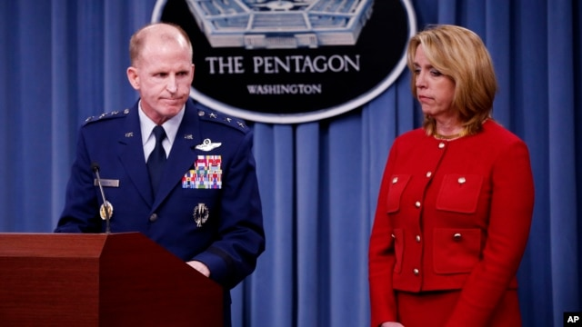 Air Force Secretary Deborah Lee James and Air Force Global Strike Command (AFGSC) Commander Lt. Gen. Stephen Wilson, finish their statements before taking questions during a news conference at the Pentagon, March 27, 2014