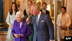 Britain's Prince Charles, Prince of Wales (C) walks with his mother Britain's Queen Elizabeth II (2L), and his wife Britain's Camilla, Duchess of Cornwall (3L), and his sons and their wives, Britain's Prince William, Duke of Cambridge (4L) and Britain's C