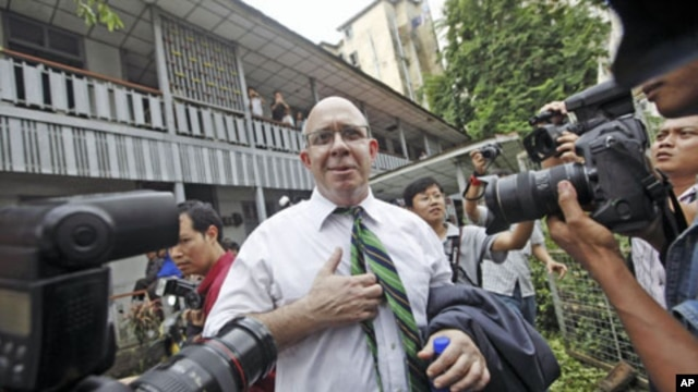 Australian journalist Ross Dunkley, co-founder of the Myanmar Times, talks to reporters after his court hearing at Kamaryut township in Yangon, June 30, 2011
