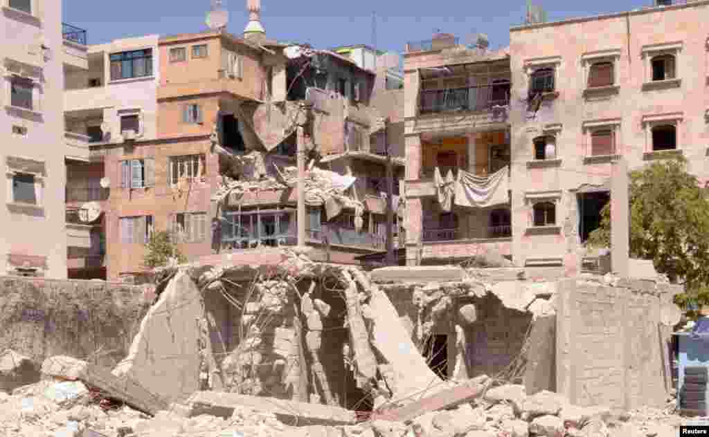 Buildings that were damaged after an exchange of fire between Free Syrian Army fighters with regime forces in the Seif El Dawla neighborhood Aleppo.