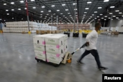 FILE - Boxes containing the Moderna COVID-19 vaccine are prepared to be shipped at the McKesson distribution center in Olive Branch, Mississippi, U.S. December 20, 2020. (Paul Sancya/Pool via REUTERS/File Photo/File Photo)