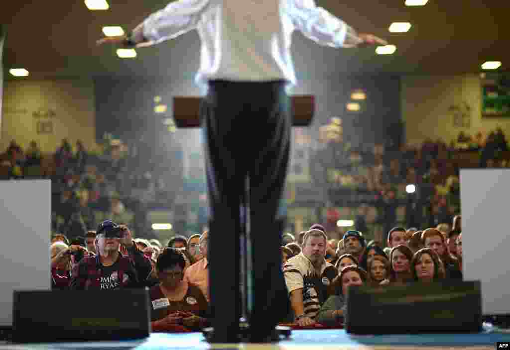 Supporters listen to Republican Presidential candidate Mitt Romney during a rally at the Veterans Memorial Coliseum in Marion, Ohio, October 28, 2012.