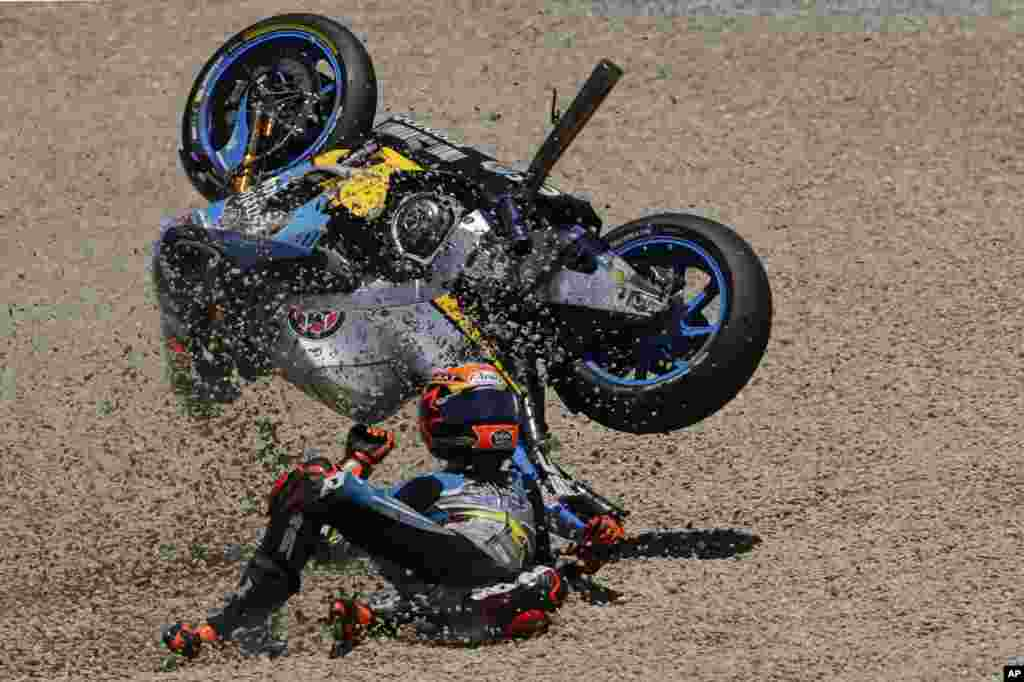 MotoGP rider Tito Rabat of Spain falls from his bike at the Spanish Motorcycle Grand Prix at the Jerez racetrack in Jerez de la Frontera.