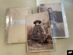This July 8, 2021 image of photographs archived at the Center for Southwest Research at the University of New Mexico in Albuquerque, New Mexico, shows Indigenous students who attended the Ramona Industrial School in Santa Fe. (AP Photo/Susan Montoya Bryan