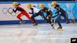 From left, Li Jianrou of China, Elise Christie of Britain, Arianna Fontana of Italy and Park Seung-hi of South Korea start in a women's 500m short track speedskating final at the Iceberg Skating Palace during the 2014 Winter Olympics in Sochi, Russia, Feb. 13, 2014.