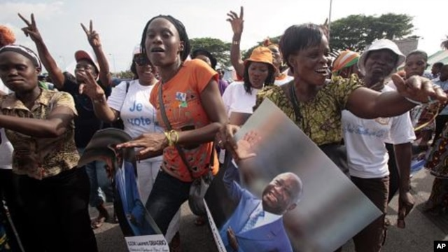 Women show support to Ivory Coast President Laurent Gbagbo during a rally called by Ivory Coast youth minister Charles Ble Goude and others in Abidjan, Ivory Coast.