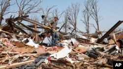 Zach Champion walks through the rubble of his mobile home looking for his belongings, in the Steelman Estates Mobile Home Park, destroyed in Sunday's tornado, near Shawnee, Oklahoma, May 20, 2013.