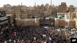 Shiite rebels known as Houthis gather to protest against Saudi-led airstrikes, during a rally in Sanaa, Yemen, April 1, 2015.