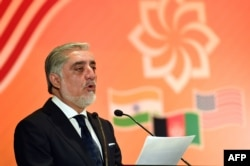 FILE - Afghanistan Chief Executive Officer Abdullah Abdullah delivers the keynote address at the US-sponsored trade and investment initiative 'Passage To Prosperity' in the Indian capital in New Delhi on Sept. 28, 2017.