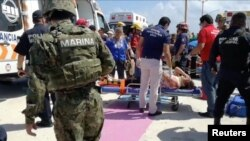 Emergency crews at the scene of an explosion at Playa del Carmen, Quintana Roo, Mexico, Feb. 21, 2018.