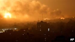 加沙城一個地區遭遇以色列空襲後煙塵滾滾