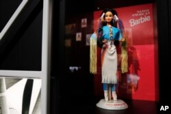 """A """"Native American Barbie"""" doll is among the items on display at the """"Americans"""" exhibit at the Smithsonian's National Museum of the American Indian in Washington, Feb. 9, 2018."""