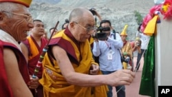 His Holiness the Dalai Lama opening the name plate of the newly installed statue of Gyalwa Jampa at Disket Monastery in Ladakh's Nubra valley, on 25 July 2010