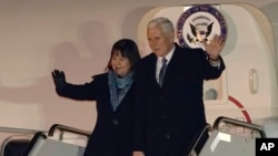 U.S. Vice President Mike Pence and his wife Karen walk upon their arrival at Yokota Air Base on the outskirts of Tokyo, Tuesday, Feb. 6, 2018. Vice President Pence's six-day swing through Asia will include a stop at the Winter Olympics in South Korea. (AP Photo/Shizuo Kambayashi, Pool)
