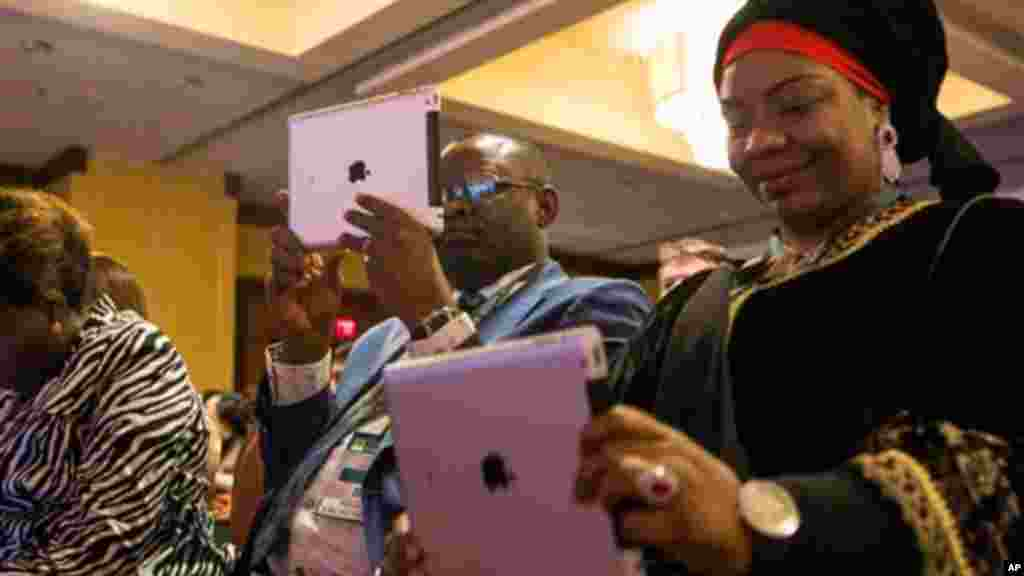 Misan Ukubeyinje, commissioner of the Ministry of Agriculture and Natural Resources for the Delta State of Nigeria, left, and Baraka Sani, commissioner of the Kano State Ministry of Agriculture and Natural Resources in Nigeria, record video on iPads as fo