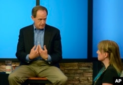 Pennsylvania's U.S. Sen. Pat Toomey answers a question from Nancy Rohrbaugh, of Dillsburg, Pa., right, during an hourlong question-and-answer session in the studios of WHTM-TV, July 5, 2017 in Harrisburg, Pa. Toomey took questions in front of a live audience in public for the first time this year.