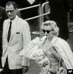 """Marilyn Monroe arrives in London, with husband Arthur Miller, to film """"The Prince and the Showgirl"""" in 1956."""