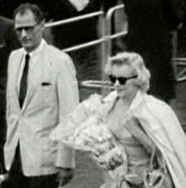 "Marilyn Monroe arrives in London, with husband Arthur Miller, to film ""The Prince and the Showgirl"" in 1956."