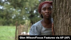 "This image released by Focus Features shows Cynthia Erivo as Harriet Tubman in a scene from ""Harriet,"" a film that will be featured during the Toronto Film Festival."