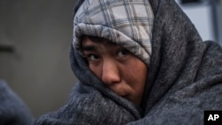FILE - An Afghan refugee is seen at the railway station of Sid, where Serbian authorities send them to Croatia. The Taliban claims it has ceased sending threatening letters and is urging Afghans to stay home.