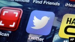 FILE - A Twitter app on an iPhone screen is shown.