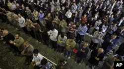 Iranian worshippers perform their Eid al-Adha prayers at Tehran University campus in Tehran, Iran. Even Shi'ite clergy who do not share the government's views -- are being targeted by authorities.