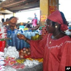 Young women operates small business in Freetown after receiving training